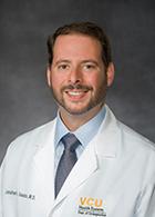 Jonathan E Isaacs, MD